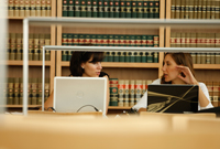 Law students study together at a table in the law library