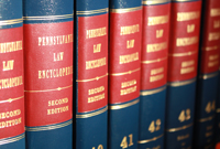 Thick volumes of the Pennsylvania Law Encyclopedia fill a shelf in the law library